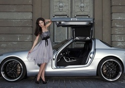 Model Katja Runiello posing with a Mercedes AMG