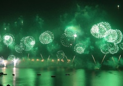 beautiful green fireworks in a harbor
