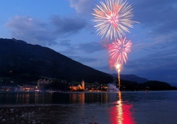 fireworks over an austrian lakeside town