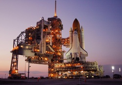 Space Shuttle Discovery on launch pad at night