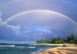 rainbow above a beach