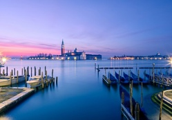 boat piers across the lagoon from venice at sunset