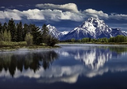 mount moran above snake river in the grand tetons