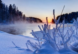 steam rising from a river in winter