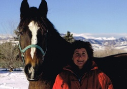 a true cowgirl with horse in the winter