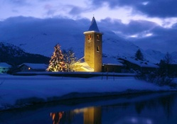 lighted church in a town in switzerland