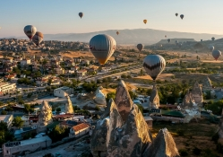 hot air balloons over a turkish town