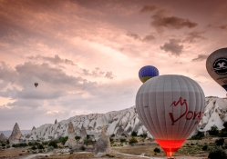 balloons over rock formations in bulgaria