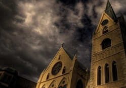 church rising to a stormy sky