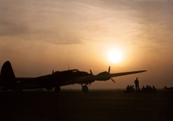 Sunset silhouette of a B_17 flying fortress