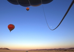 Hot Air Balloons Take Off at Sunrise Namib Desert Namibia.