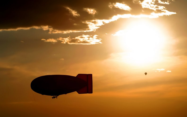 blimp_silhouette_and_hot_air_balloon.jpg