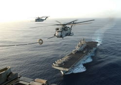 Helicopter Refueling Above an Aircraft Carrier
