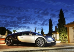 super bugatti at a super mansion
