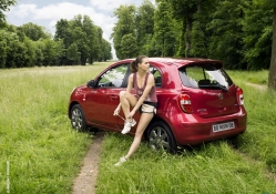 Nissan Micra with a girl on the way