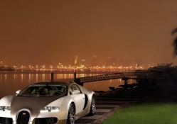 gold bugatti veyron by the river