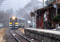 commuter train arriving in winter
