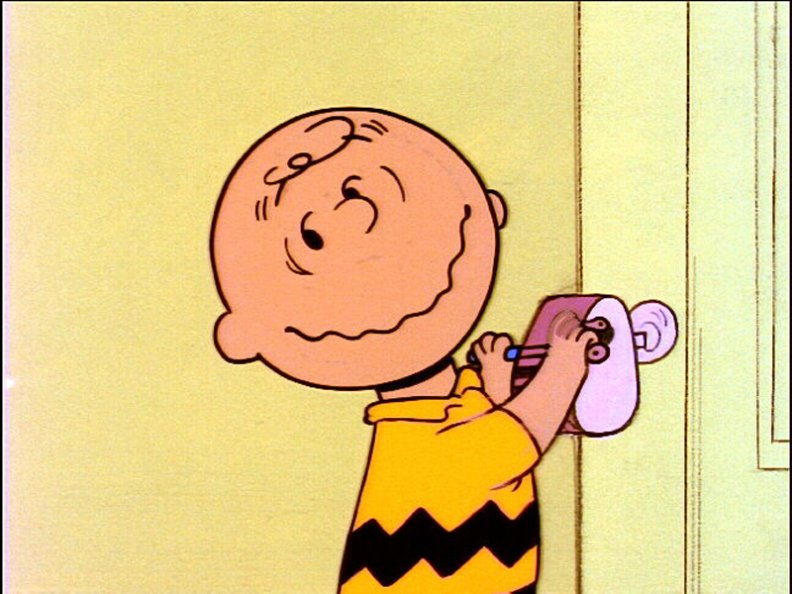 charlie_brown_looking_at_red_haired_girl.jpg