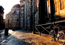 bicycle on a florence street at sunrise