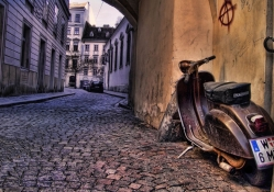 old plaggio scooter in side street in italy hdr
